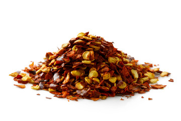 A pile of coarsely ground chilli peppers isolated on white.