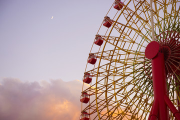 Ferris wheel with sunset background.