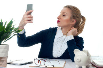 Business woman making photo on smartphone.