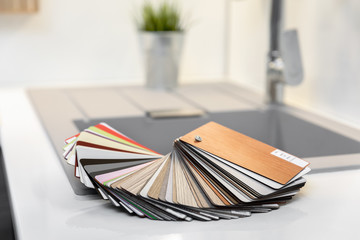 kitchen interior design - furniture material samples on worktop