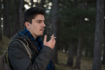 young man holding the cigar