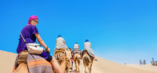 Safari tourism on camels. Sahara desert, Tunisia, North Africa