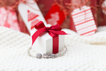 Present boxes. Jewelry. Silver bracelet with charms.
