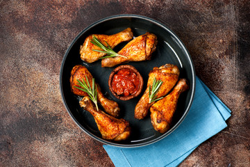 Grilled fried chicken legs with spicy sauce