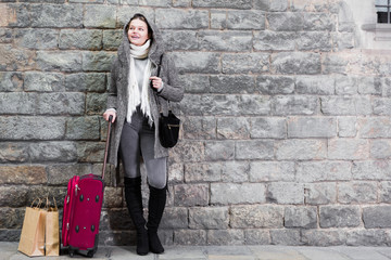 teenager girl with baggage in hood
