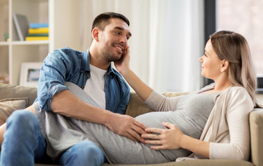 happy man with pregnant woman at home