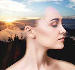 Portrait of woman and sunset sky