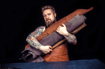Man working with leather being keen on his buisness