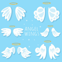 Angel wings set. Cartoon vector illustration on blue background.