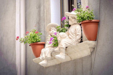 windowsill statues children background flowerpots balcony window sill