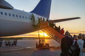 People boarding plane, travelers  Wall mural