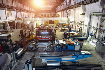 Industrial factory with equipment tools in large workshop or warehouse, industrial background