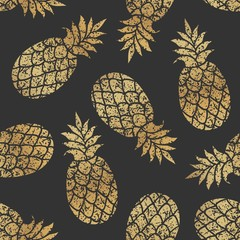 Golden pineapples seamless vector pattern on black background.
