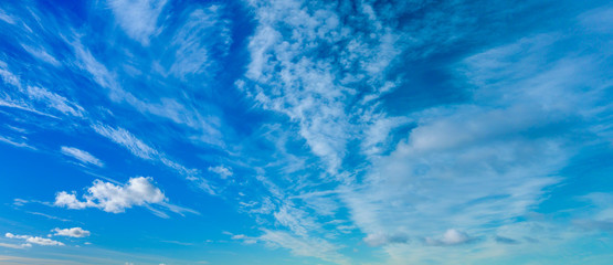 Blue sky with the fluffy clouds