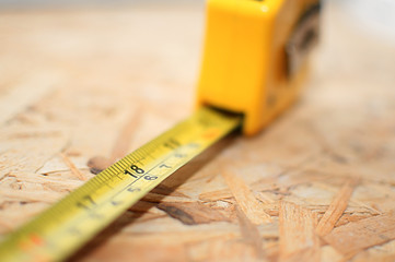 A tape measure stretched out with the focus on 18 inches
