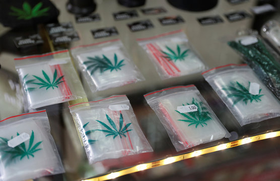 Cannabis storage bags are displayed at Triparte shop in downtown Lisbon