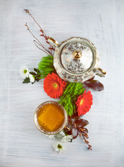 vintage, antique cup of tea decorated with flowers on white background in a shabby chic look