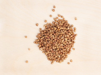 Buckwheat on a wooden surface.