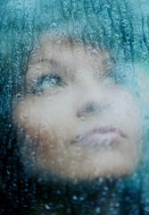 Sad young woman and a rain drops.