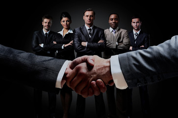 handshake on the background group of business people.