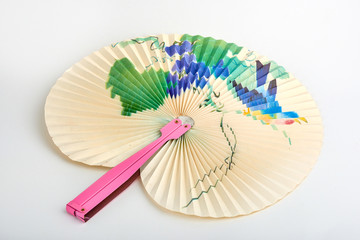 Closeup of Traditional Chinese paper fan on white background.Hand paper fan