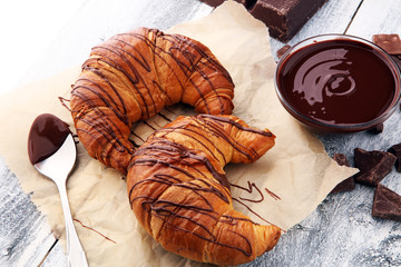 Wall Mural - Fresh homemade croissants with chocolate. Sweet bakery concept.