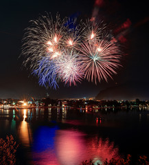 Beautiful firework display for celebration on the Grda Lake,italy,Brightly Colorful Fireworks
