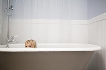 Portrait of playful girl in bathtub