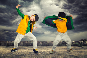 Two brothers dancing break dance.Hip-hop style.The cool kids.Children's fashion.