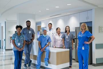 Portrait of confident doctors and nurses at hospital reception