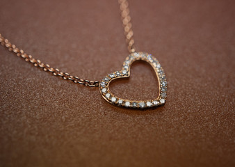 Heart-shaped necklace of a rose gold and diamonds