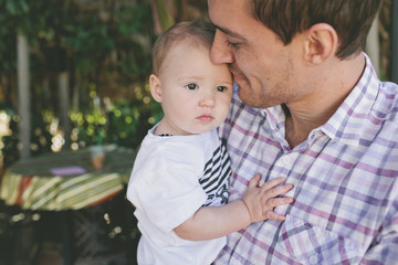 Father carrying cute daughter at birthday party