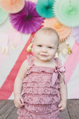 Portrait of baby girl against decoration at birthday party