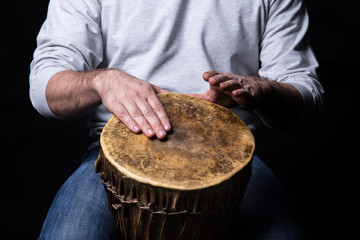 Man playing african djembe drum