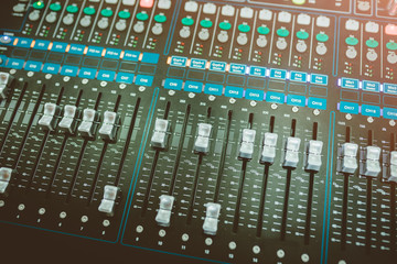 Wide angle photo of black sound mixer controller with knobs
