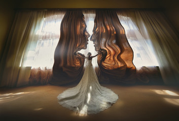 Bride opens brown curtains standing before bright window. Silhouettes of faces of a couple in love. Advertising curtains. Fantasy. Creative. The concept. Surrealism, mysticism.