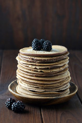 Chocolate pancakes with blackberries.