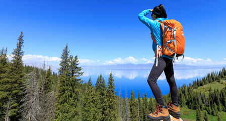 successful Hiker looking at the view on mountain top Wall mural
