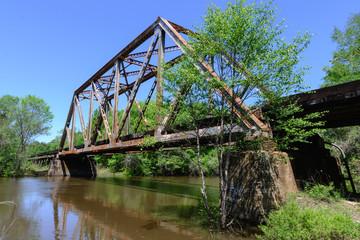 Old metal truss railroad bridge in florida