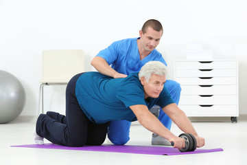 Physiotherapist working with patient in rehabilitation centre