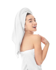 Young woman in towel on white background