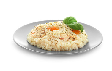 Plate with delicious pumpkin risotto on white background