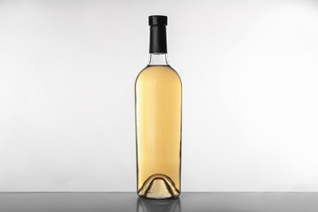 Bottle with wine on white background