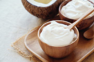 homemade organic coconut greek yogurt in wooden bowl, probiotics food for gut health, keto, ketogenic diet, dairy free and gluten free, healthy plant based vegan food