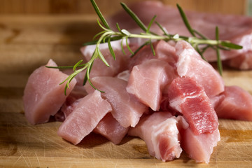 Raw pork ready to Cook on a wooden cutting board