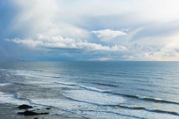 Canon Beach. Oregon Coast. Haystack Rock. Pacific Northwest coastline. Ocean waves. Cloudy sunset.