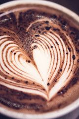 Hot chocolate drink with heart shape latte art