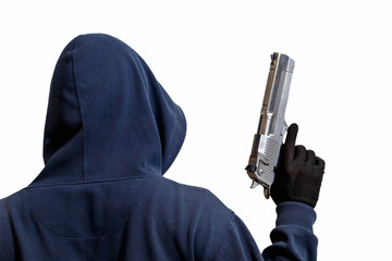 Hooded man with a gun in hand isolated on white background