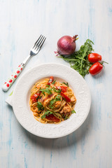 pasta with fresh salmon tomatoes and arugula