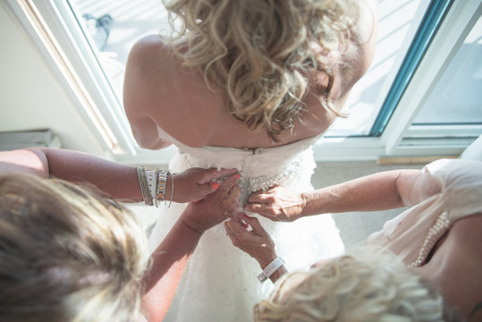Bride Getting Dressed for her Wedding